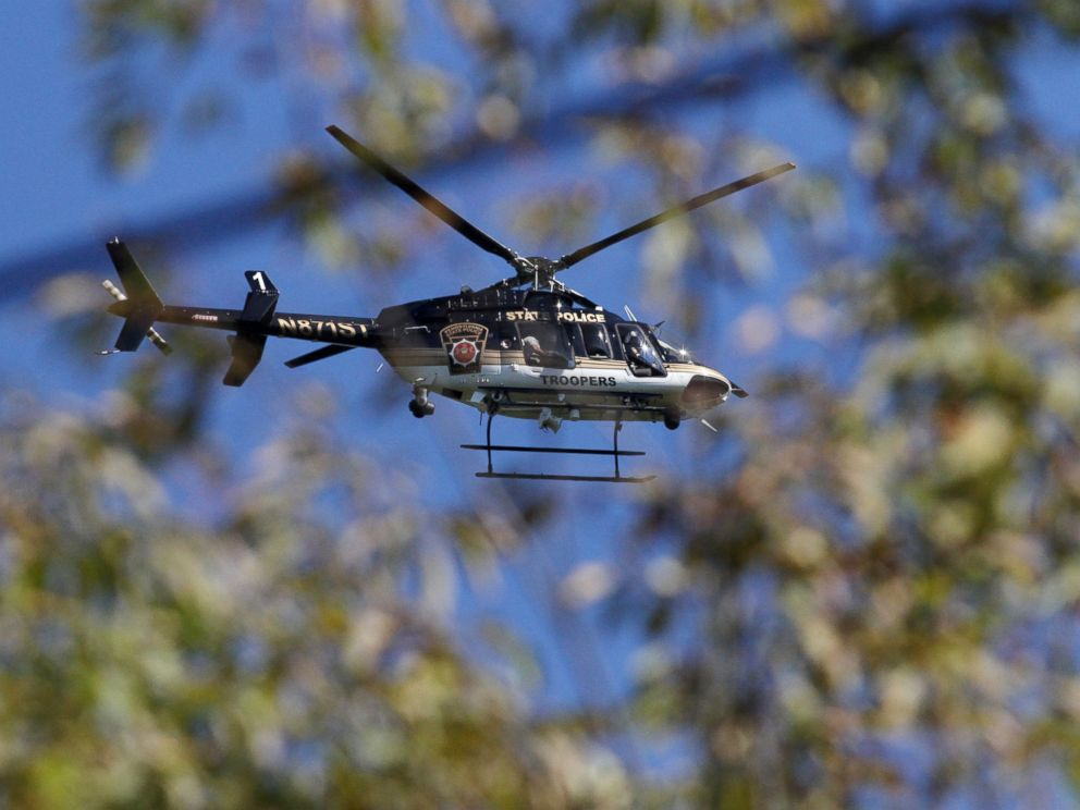 PHOTO: A Pennsylvania State Police helicopter searches for Eric Frein near Canadensis, Pa., on Sept 23, 2014.
