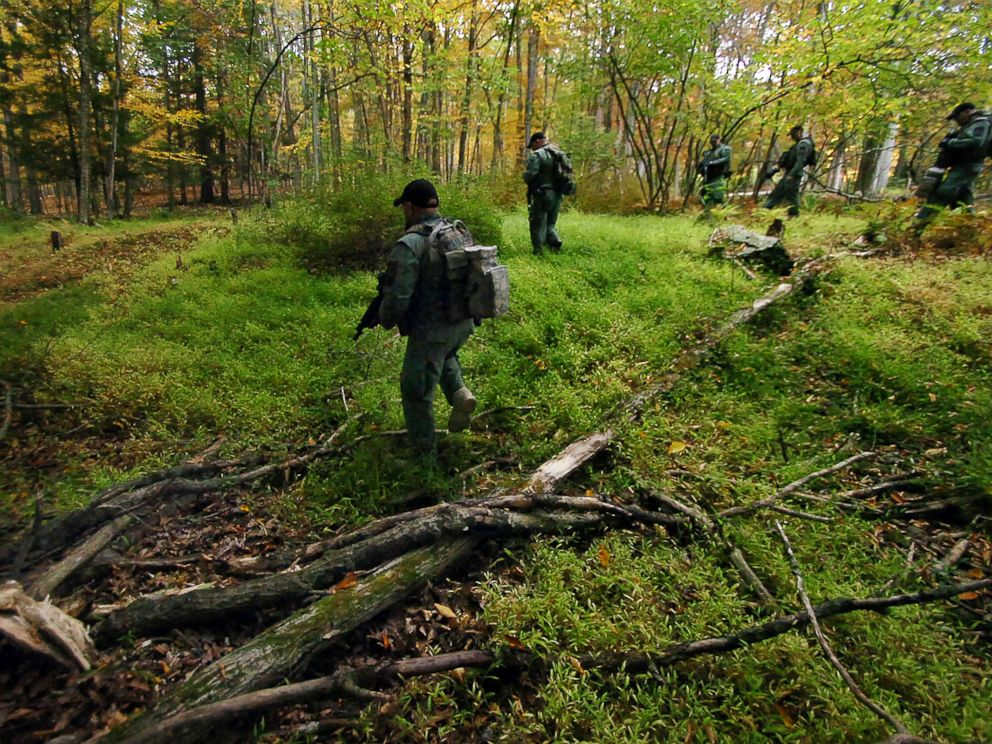 PHOTO: Members of the Scranton Police Special Operations Group search the woods, Oct. 2, 2014, in Barrett Township near Canadensis, Pa., for suspected killer Eric Frein.