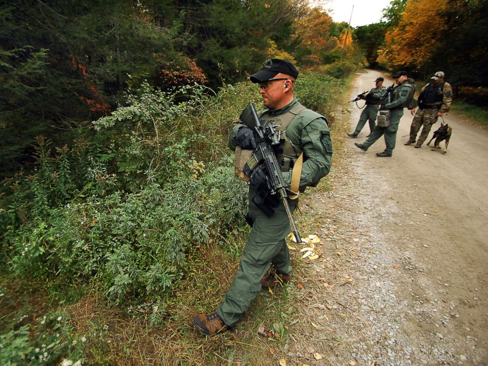 PHOTO: A member of the Scranton, Pa., Police Special Operations Group, prepares to ender the woods, Oct. 2, 2014, in Barrett Township, Pa., to search for suspected killer Eric Frein.