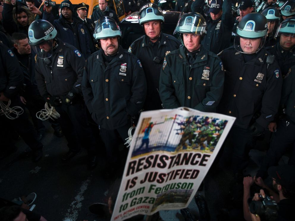 PHOTO: Police block demonstrators as they attempt to make their way through Times Square in protest against a grand jurys decision on Monday not to indict Ferguson police officer Darren Wilson in the shooting of Michael Brown, Nov. 25, 2014, in New York.