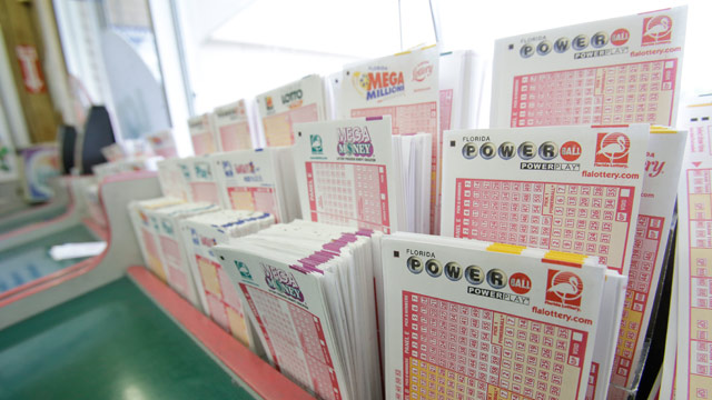 PHOTO: Powerball tickets, right, along with other lotto tickets are seen Thursday, May 16, 2013, at a convenience store in Orlando, Fla.