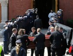 PHOTO: An honor guard from area Fire Departments salute as pallbearers carry the casket of Boston Marathon bomb victim Krystle Campbell into St. Josephs Church for her funeral in Medford, Mass., April 22, 2013.