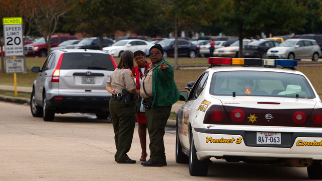 PHOTO: Law enforcement officials gather outside North Shore High School in Galena Park, Texas on Dec. 5, 2012, after police say a high school student shot himself while in the back of a patrol.