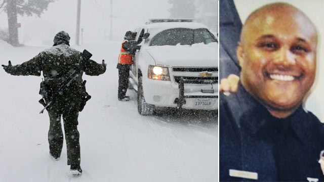 PHOTO:San Bernardino Sheriffs Department officer Steven Spagon mans a check point during the search for fired Los Angeles officer, Christopher Dorner in Big Bear Lake, Calif., Feb. 8, 2013.