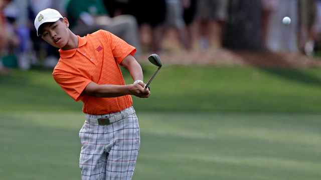 PHOTO: Amateur Guan Tianlang, of China, chips to the first green during the second round of the Masters golf tournament Friday, April 12, 2013, in Augusta, Ga.