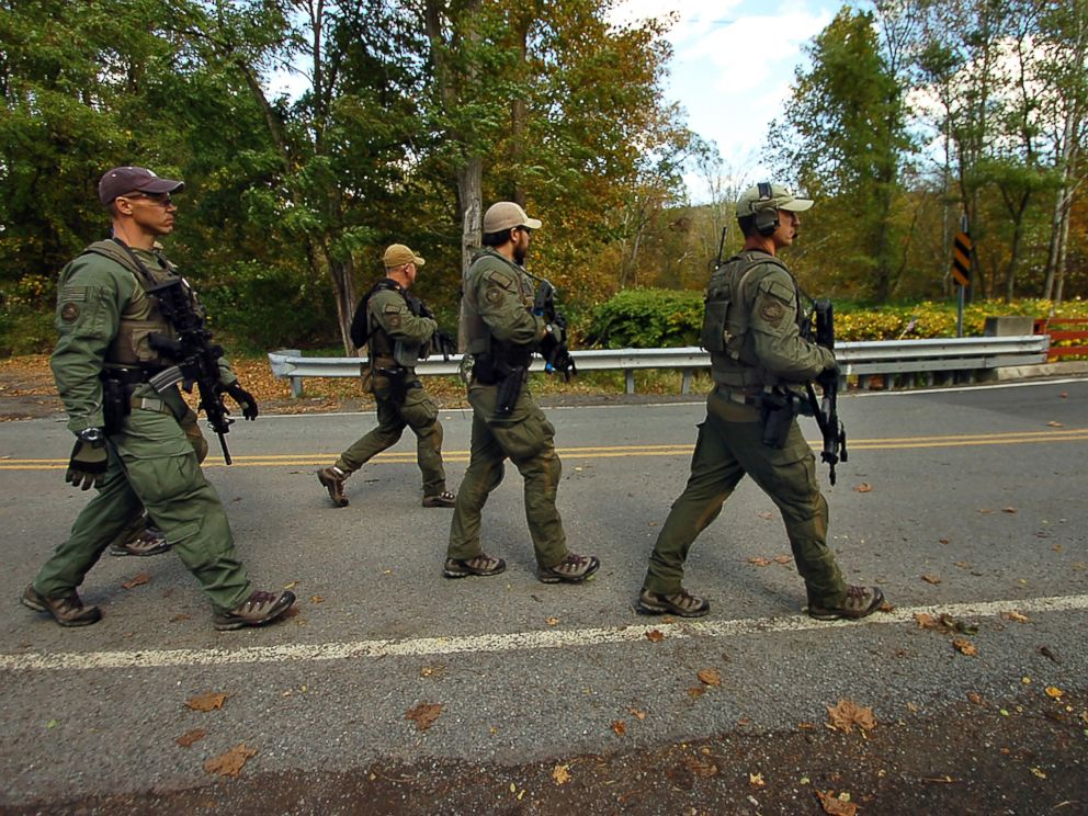 PHOTO: Members of the FBI SWAT team walk to the woods Oct. 8, 2014 in Price Township near Canadensis, Pa., searching for killer Eric Frein.