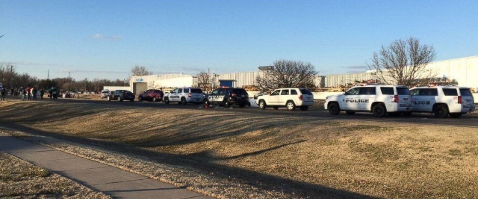 PHOTO: In this photo provided by KWCH-TV, police vehicles line the road after reports of a shooting at an industrial site in Hesston, Kan., on Feb. 25, 2016.