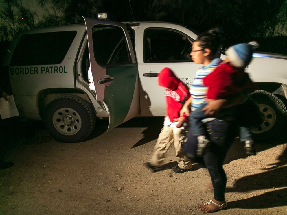 PHOTO: In this July 3, 2014 photo, a mother from Honduras traveling with her nine-year-old son and one-year-old daughter prepare to get into a U.S. Customs and Border Protection Services agents truck after crossing the Rio Grande near McAllen, Texas.