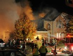 PHOTO: Firefighters work the scene where an explosion has killed two people and damaged more than a dozen homes in the Richmond Hill subdivision, Nov. 10, 2012, in Indianapolis.