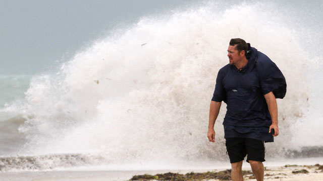 PHOTO:A man walks on the beach in Key West, Fla., Sunday, Aug. 26, 2012 as heavy winds hit the northern coast from Tropical Storm Isaac.
