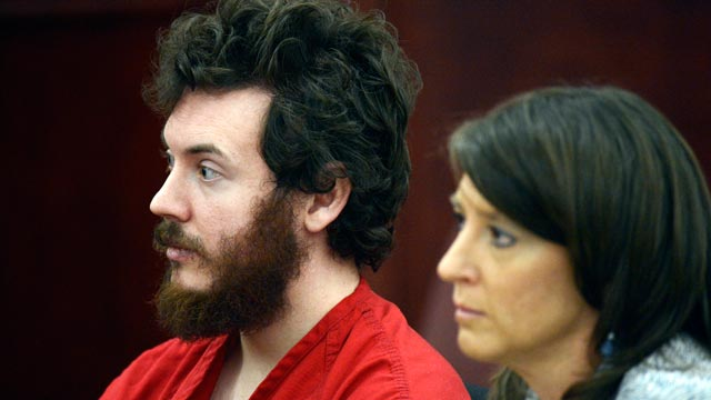 PHOTO: James Holmes sits with defense attorney Tamara Brady during his arraignment in district court in Centennial, Colo., March 12, 2013.