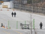 PHOTO: South Korean army soldiers walk on the empty road after South Korean vehicles which were refused for entry to North Korea at the customs, immigration and quarantine office in Paju, South Korea, near the border village of Panmunjom on April 3, 2013.