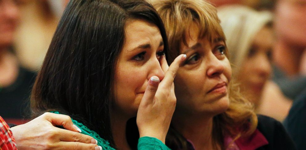 PHOTO: Lacey Scroggins, left, is comforted by her mother Lisa Scroggins during a church service at the New Beginnings Church of God, Sunday, Oct. 4, 2015, in Roseburg, Ore.