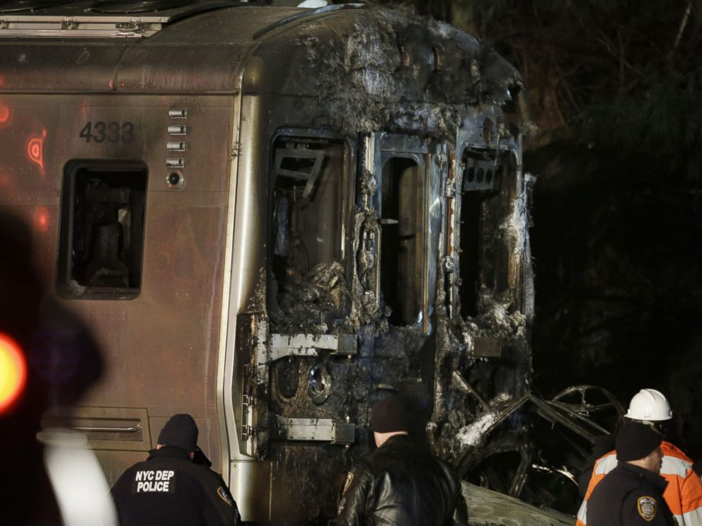 PHOTO: Emergency personnel work at the scene of a Metro-North Railroad passenger train and vehicle accident in Valhalla, N.Y., on Feb. 3, 2015.