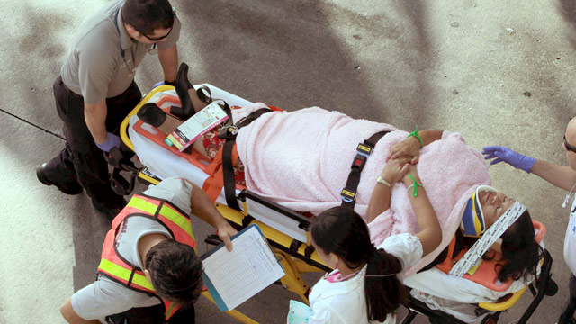 PHOTO: Emergency personnel attend to injured passengers after a bus accident at Miami International Airport on Saturday, Dec. 1, 2012 in Miami.