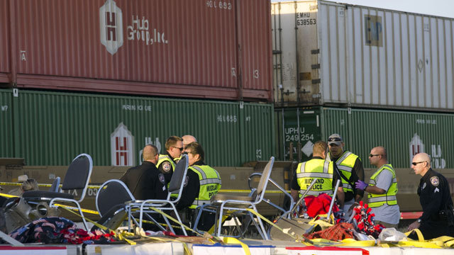 PHOTO:Midland police, fire and sheriffs respond to an accident where a trailer carrying veterans in a parade was struck by a train crossing in Midland, Texas, Thursday, Nov. 15, 2012.