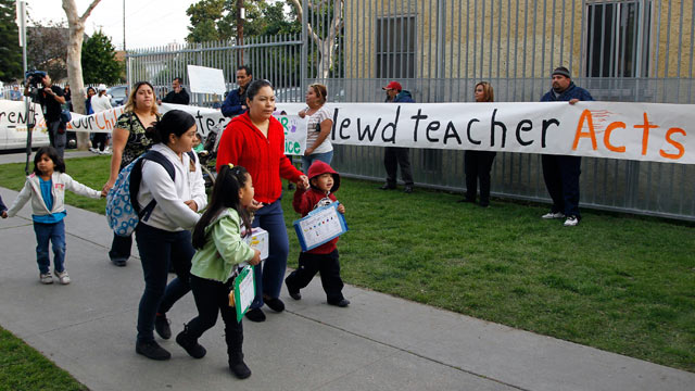 PHOTO: Parents bring their children to school as others protest outside Miramonte Elementary school in Los Angeles Feb. 6, 2012.