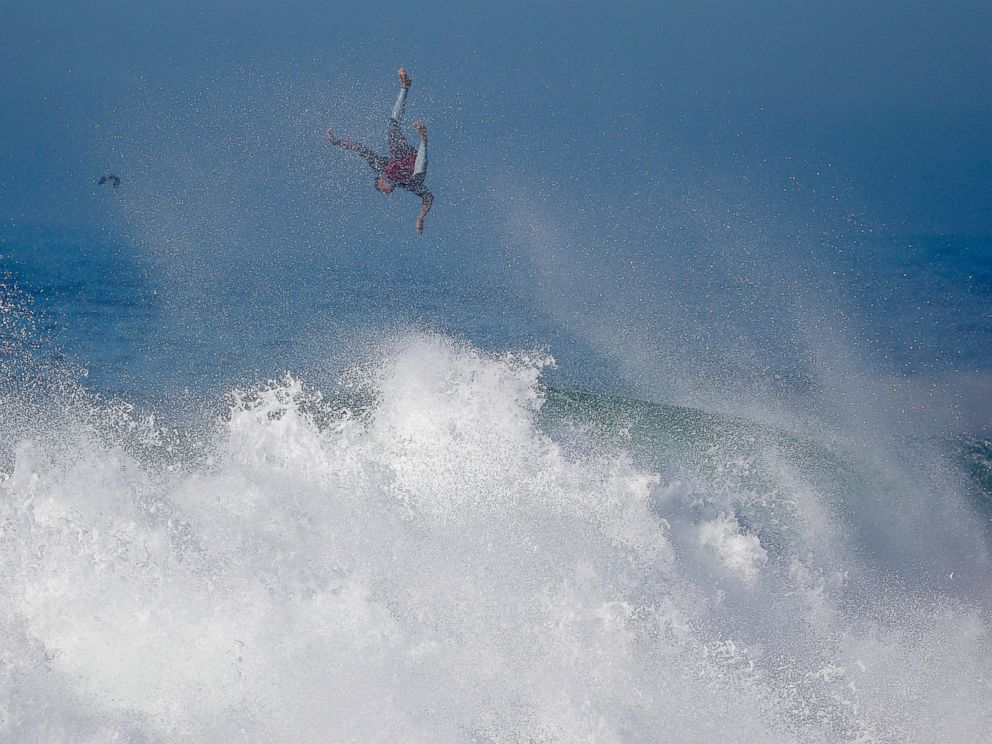 PHOTO: A surfer flies off a wave at the wedge in Newport Beach, Calif., Aug. 27, 2014.