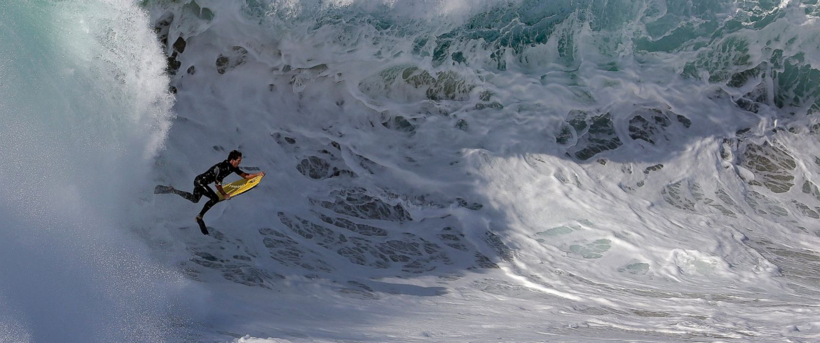 PHOTO: A bogieboarder rides a wave at the wedge in Newport Beach, Calif., Aug. 27, 2014.