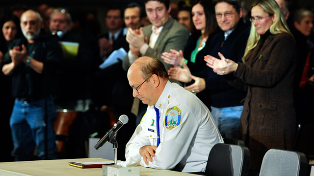 PHOTO: Newtown Chief of Police Michael Kehoe receives a standing ovation from families of the victims of the Sandy Hook Elementary School shooting during a hearing to a legislative task force on gun violence and childrens safety at Newtown High School in