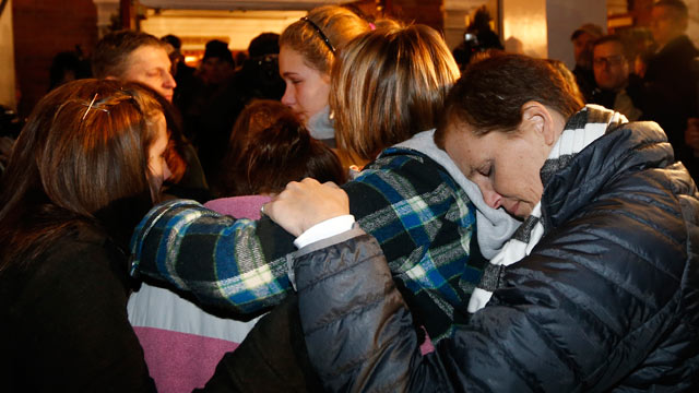 PHOTO: Girls embraces outside St. Rose of Lima Roman Catholic Church, which was filled to capacity, during a healing service held in for victims of an elementary school shooting in Newtown, Conn., Dec. 14, 2012.