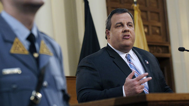 PHOTO: A New Jersey state trooper stands nearby in the Assembly Chamber of the Statehouse in Trenton, N.J., as Gov. Chris Christie delivers his budget address in this Feb. 21, 2012 file photo.