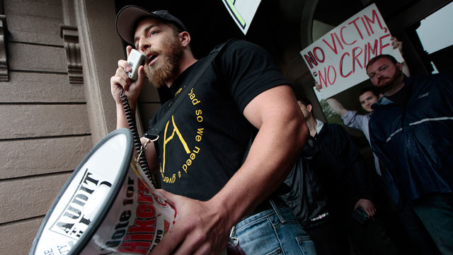 PHOTO: Adam Kokesh, a Marine Corps veteran from Virginia speaks through a megaphone in front of Town Hall in Middleborough, Mass., June 24, 2012.