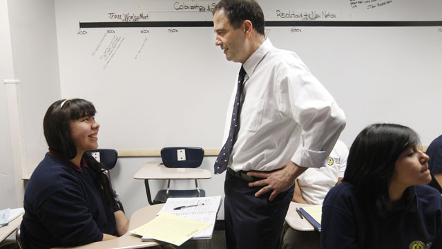 PHOTO: Noble Street College Prep CEO Mike Milke talks with student Gabriela Cervantes during school in Chicago, Feb. 16, 2012.