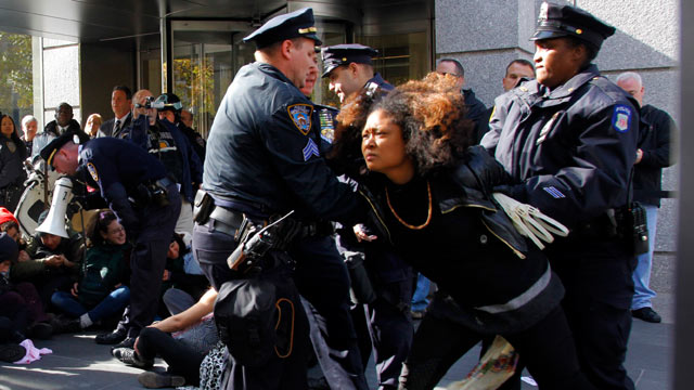 PHOTO: Police arrest Occupy Wall Street protesters as they staged a sit-down at Goldman Sachs headquarters on Nov. 3, 2011 in New York.