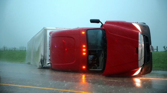 PHOTO: An overturned semitrailer rests on its side on the eastbound lanes of Interstate 40, just east of El Reno, Okla., after a reported tornado touched down, Friday, May 31, 2013.