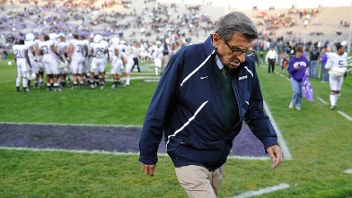 PHOTO: Penn State football coach Joe Paterno walks off the field after warm ups before Penn State's NCAA college football game in Evanston, Ill, Oct. 22, 2011.