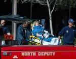 PHOTO: Woman on stretcher