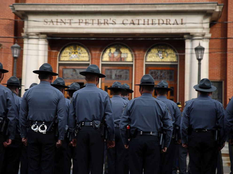 PHOTO: Law enforcement officers gather outside before a funeral service for Pennsylvania State Trooper Cpl. Bryon Dickson, Sept. 18, 2014, in Scranton, Pa.