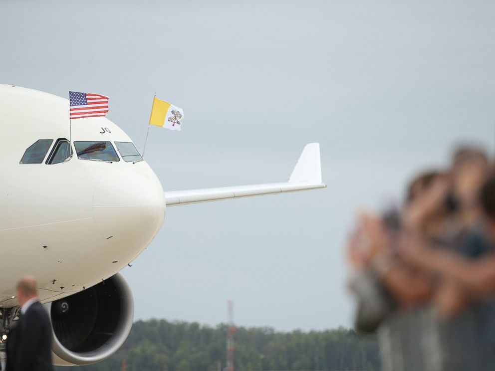 PHOTO: A crowd waves to a plane carrying Pope Francis as he arrives at Andrews Air Force Base, Md., Sept. 22, 2015.