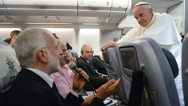 PHOTO: Pope Francis on the airplane addressing press
