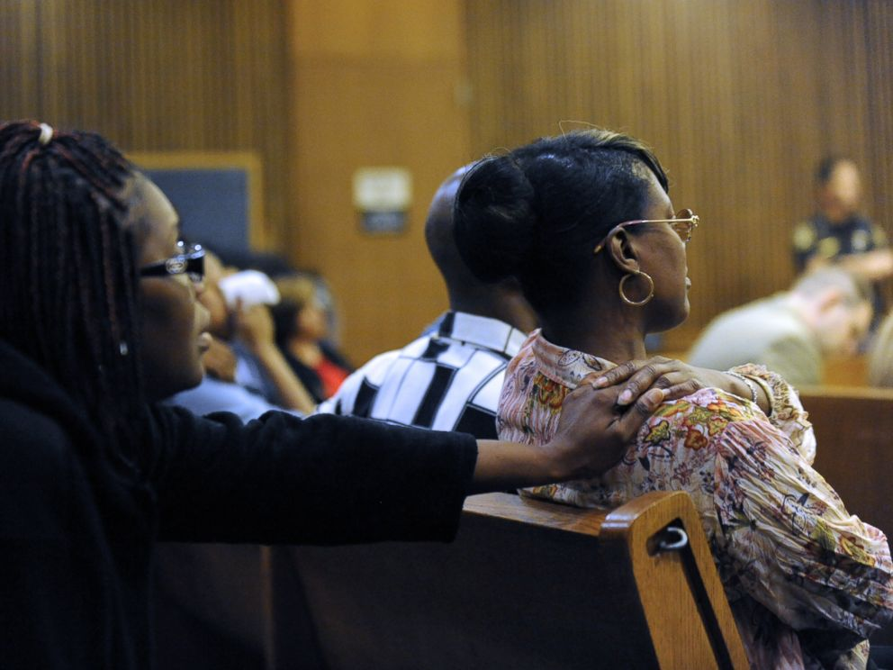 PHOTO: Monica McBride, right, reacts to photos of her deceased daughter during the Theodore Wafer trial in Detroit on July 24, 2014.