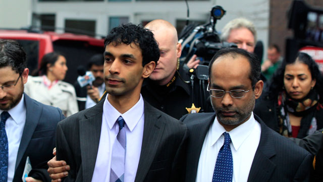 PHOTO: Dharun Ravi, center, is hugged by his father, Ravi Pazhani, right, as they leave court around noon in New Brunswick, N.J., March 16, 2012.
