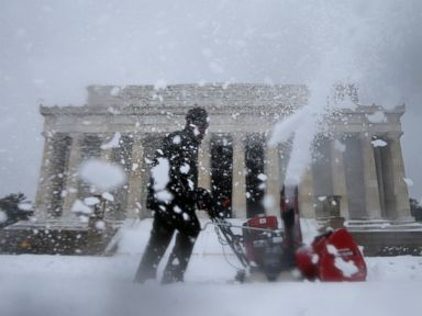 PHOTO: A Park Service employee clears snow in front of the Lincoln Memorial in Washington, Feb. 13, 2014.
