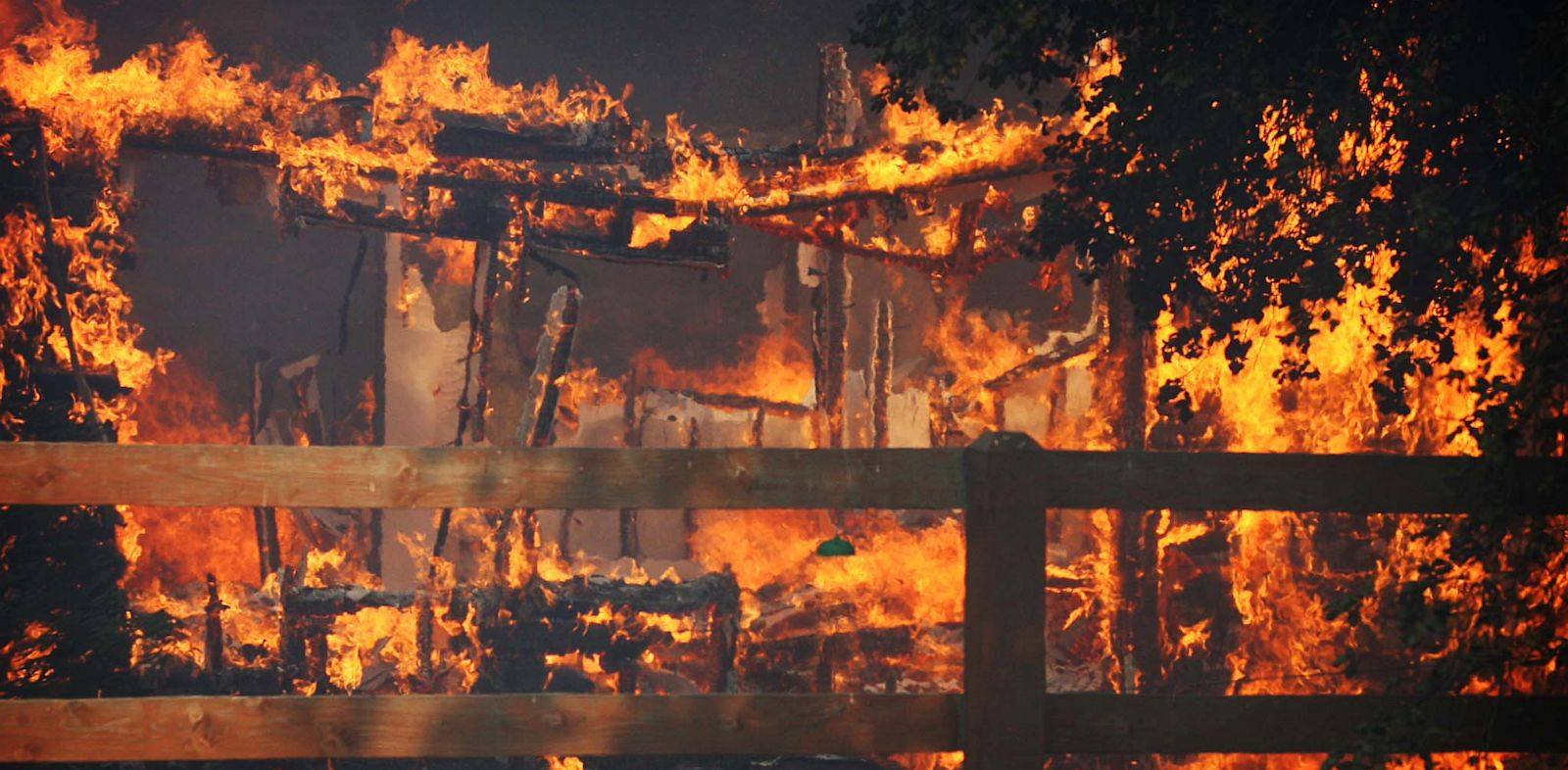 PHOTO: Multiple structures burn in the Poppet Flats area as the Silver Fire roared through the area along Hwy 243 between Banning and Idyllwild, Calif. on Wednesday, Aug. 7, 2013.