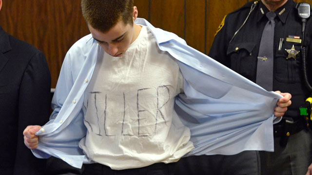 PHOTO: T.J. Lane unbuttons his shirt during sentencing, March 19, 2013, in Chardon, Ohio. Lane, was given three lifetime prison sentences without the possibility of parole for opening fire last year in a high school cafeteria in a rampage that left three