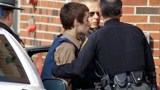 PHOTO: T.J. Lane, a suspect in the shooting of five students at Chardon High School is taken into juvenile court by Geauga County deputies in Chardon, Ohio.