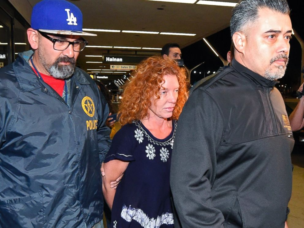 PHOTO: Tonya Couch is taken by authorities to a waiting car after arriving at Los Angeles International Airport, Dec. 31, 2015, in Los Angeles.