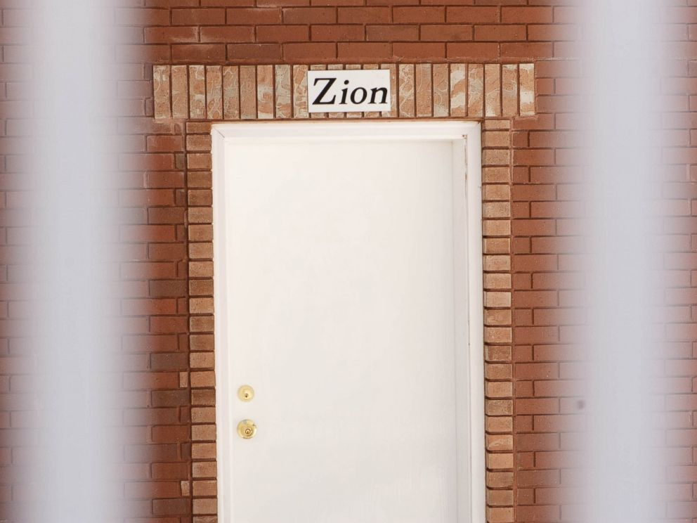 PHOTO: In this April 26, 2013 photo, a sign reads, Zion, over the door of a home intended for the family of Warren Jeffs in Hildale, Utah.
