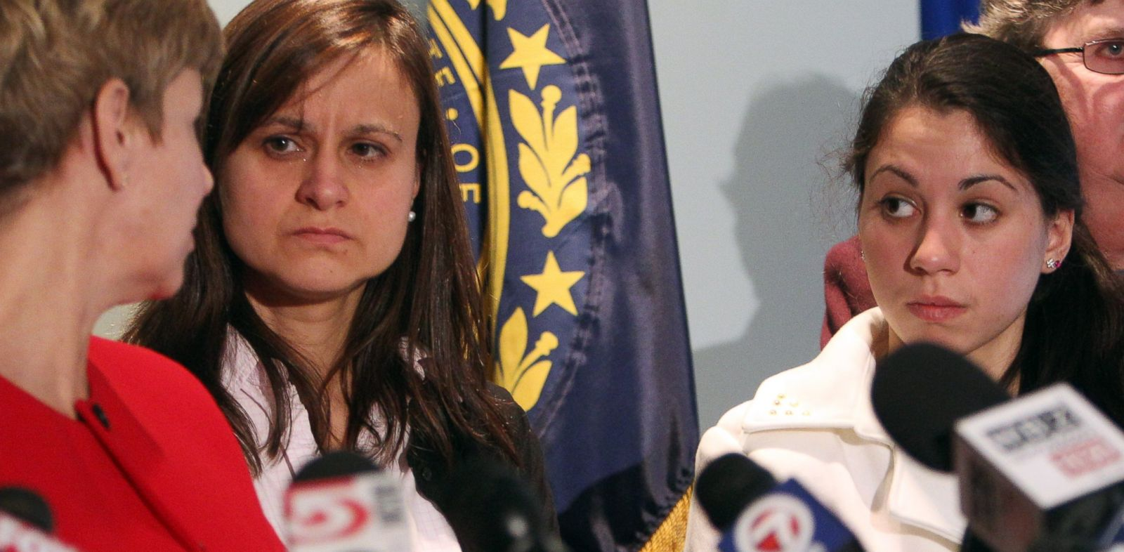 PHOTO: Zenya Hernandez, center, and her daughter, Sarah Hernandez look at Senior Assistant Attorney General Jane Young, during a news conference on Dec. 6, 2013 in Concord, N.H.