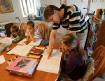 PHOTO: Uwe Romeike works with Lydia, Josua and Christian during their home schooling session in the dining room of their home in Morristown, Tenn., on April 2, 2009.
