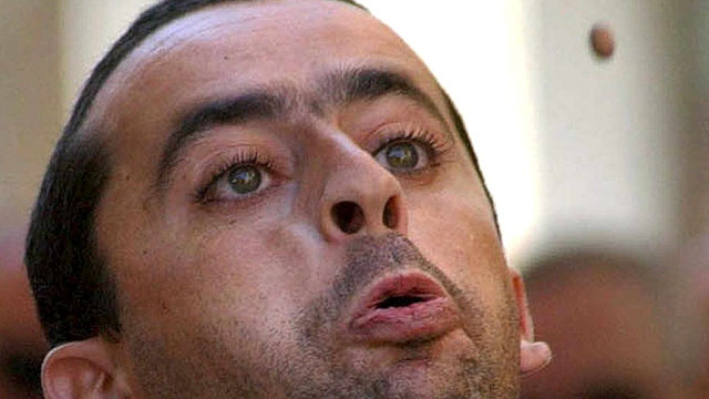 PHOTO: A man spits an olive core on Wednesday, Aug. 29, 2001 during the VII Olive Core Spitting Championship held in Cieza, in which more than a hundred people took part.