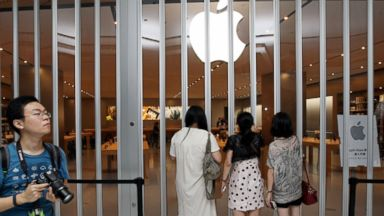 PHOTO: Customers visit the new Apple Store in Wuxi, China on Aug. 2, 2014.