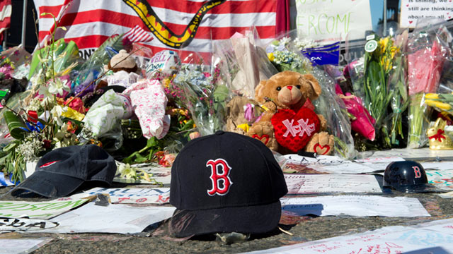 PHOTO: A Boston Red Sox cap left at a makeshift memorial on the Boston Marathon route, April 18, 2013, in Boston.