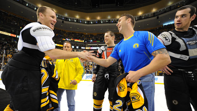 PHOTO: Shawn Thornton (L) of the Boston Bruins shakes hands with one of the first responders from the Boston Marathon tragedy after the game against the Florida Panthers at the TD Garden on April 21, 2013 in Boston.