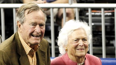 Former President George H.W. Bush and wife, Barbara, attend the NCAA Final Four semifinal basketball game in Houston, Texas, April 2, 2011.